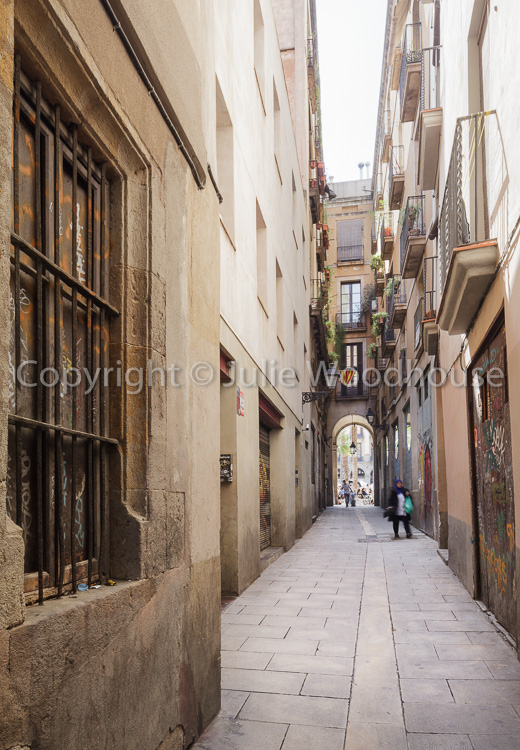 photo showing Carrer Dels Tres Llits One Of The Many Narrow Streetsleading Off The Placa Reial In The Barri Gotic,