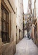 Thumbnail image of Carrer dels Tres Llits one of the many narrow streetsleading off the Placa Reial in the Barri Gotic,