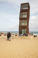 People On The Beach At Barceloneta With Rebecca Horns Sculpture  L'Estel Ferit (The Wounded Shooting