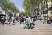 Crowds Walking And Watching A Living Statue On La Rambla, Barcelona, Catalonia, Spain