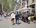 People Walking On La Rambla By An Artist Stall, Barcelona, Catalonia, Spain