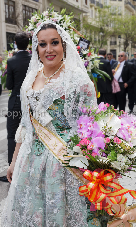photo showing Woman In Traditional Dress During Procession At The Festival Of San Vicente Ferrer, The Patron Saint