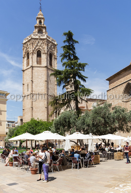 photo showing Pavement Cafe And Tourists In Front Of The Cathedral, Valencia, Spain